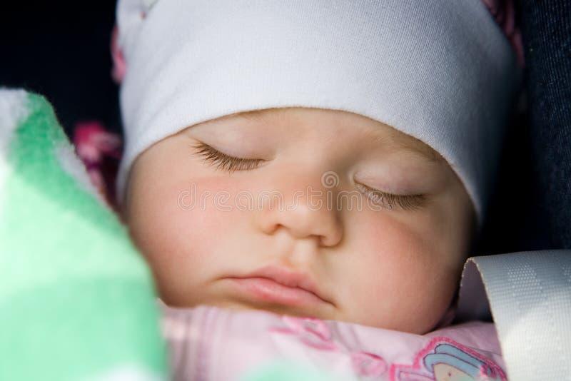 Un bambino addormentato fotografie stock