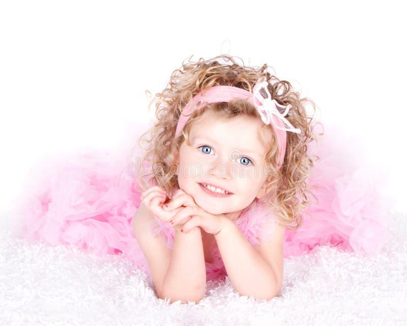 Un bambino dai capelli riccio eyed blu fotografia stock