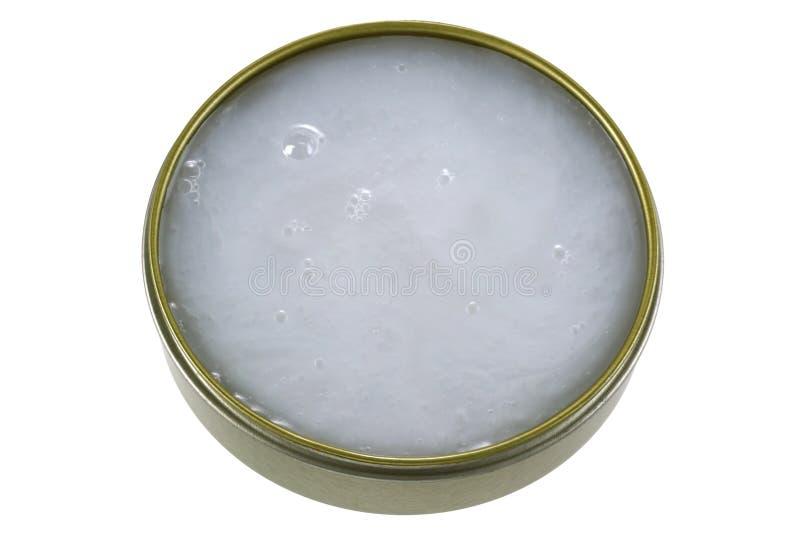 Un barattolo di Mink Oil, lubrificare cuoio immagine stock