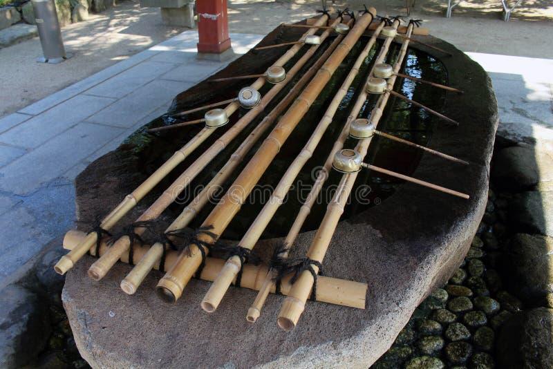 Un bassin employé dans un rituel pour épurer La PIC a été prise à un temple image libre de droits