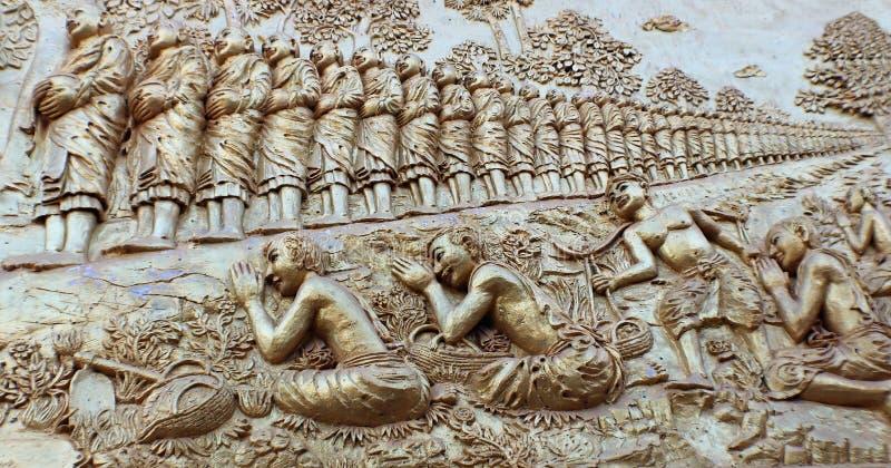 Un bastidor de una larga cola de buddhas fotografía de archivo