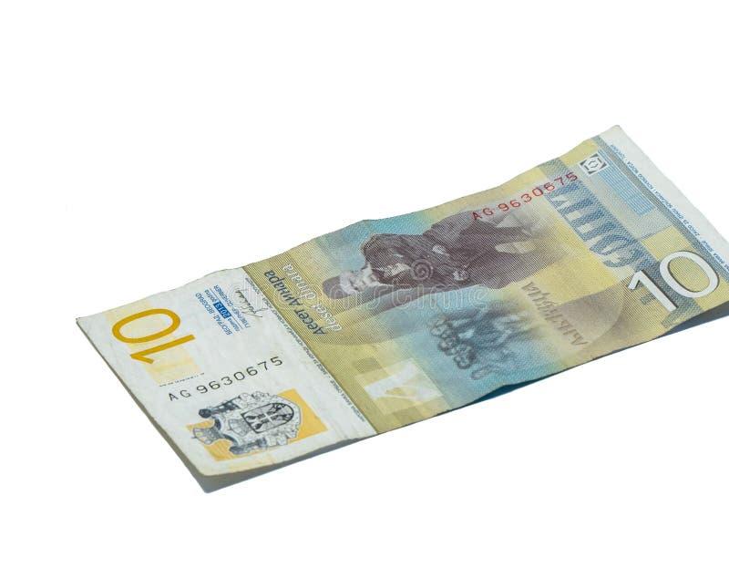 Un billet de banque en valeur 10 dinars serbes avec un portrait d'un linguiste Vuk Karadzic d'isolement sur un fond blanc image stock