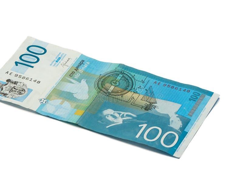 Un billet de banque en valeur 100 dinars serbes avec un portrait d'un scientifique et d'un inventeur Nikola Tesla d'isolement sur photos libres de droits