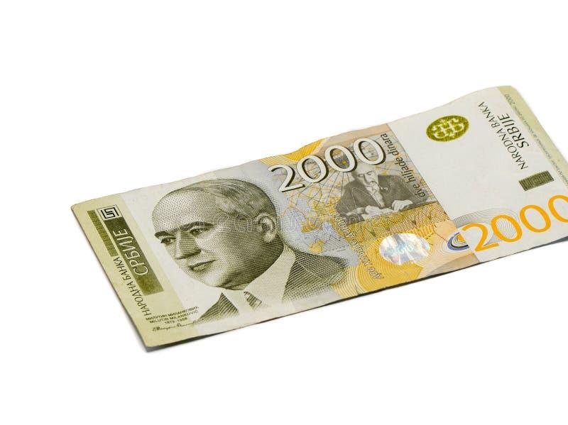 Un billet de banque en valeur 2000 dinars serbes avec un portrait d'un scientifique Milutin Milankovic de climat a isolé sur un f images libres de droits