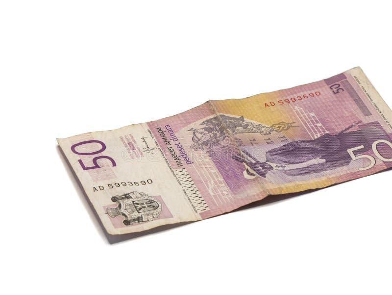 Un billet de banque en valeur 50 dinars serbes avec un portrait de violoniste Stevan Mokranyats d'isolement sur un fond blanc photos stock