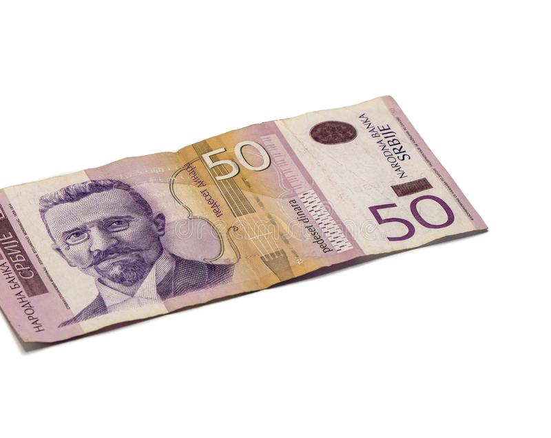 Un billet de banque en valeur 50 dinars serbes avec un portrait de violoniste Stevan Mokranyats d'isolement sur un fond blanc image libre de droits