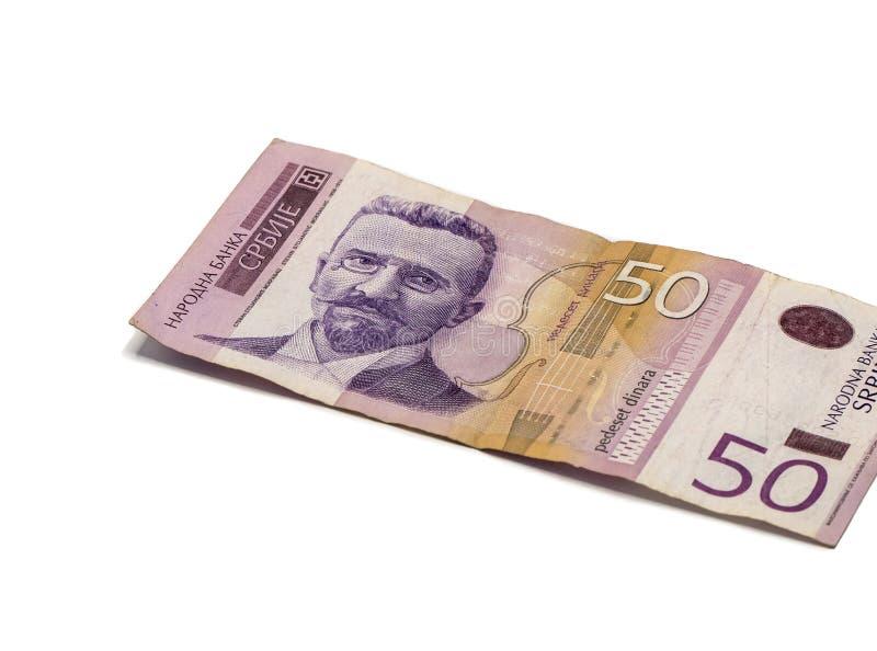 Un billet de banque en valeur 50 dinars serbes avec un portrait de violoniste Stevan Mokranyats d'isolement sur un fond blanc photos libres de droits