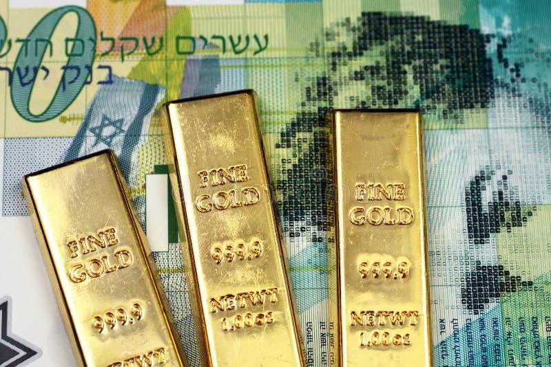 Un billet de banque israélien du shekel vingt avec trois petites barres d'or photo stock