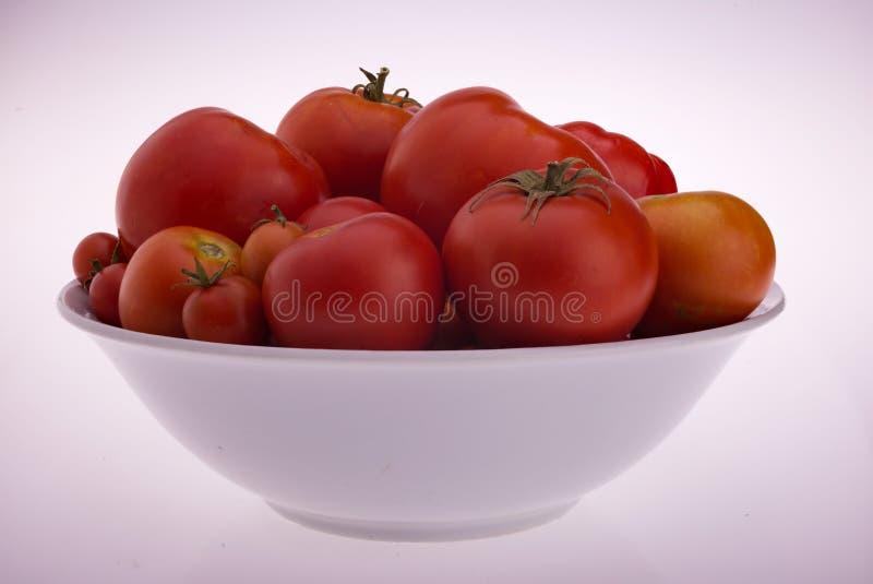 Un bol de tomates photo stock