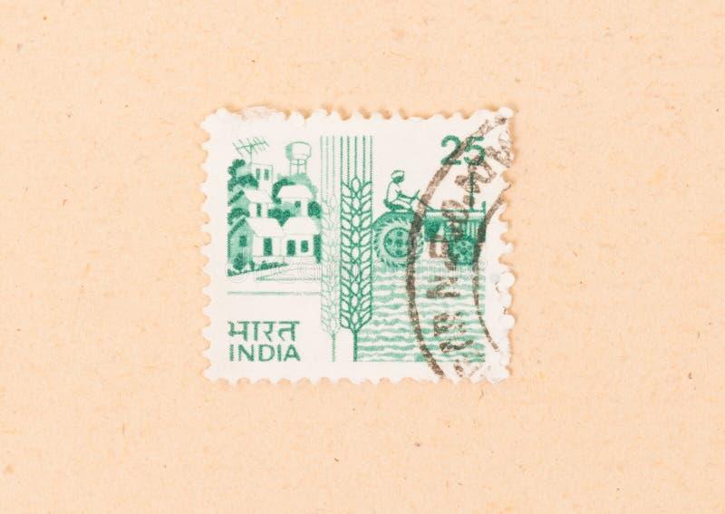 Un bollo stampato in India mostra l'agricoltura in India, circa 1970 immagine stock libera da diritti