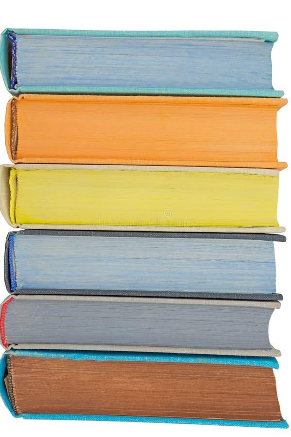 Un bon nombre de livres colorés d'isolement sur le blanc photos libres de droits