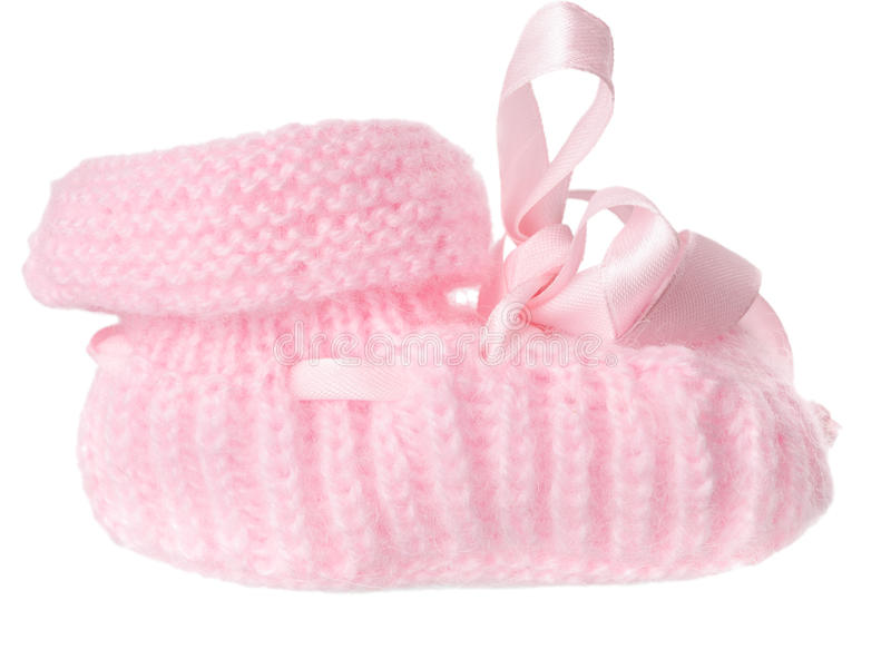 Un bootee rosado del bebé con un arqueamiento imagen de archivo libre de regalías