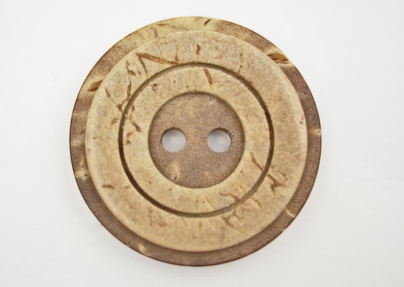 Un botón redondo marrón imagen de archivo libre de regalías