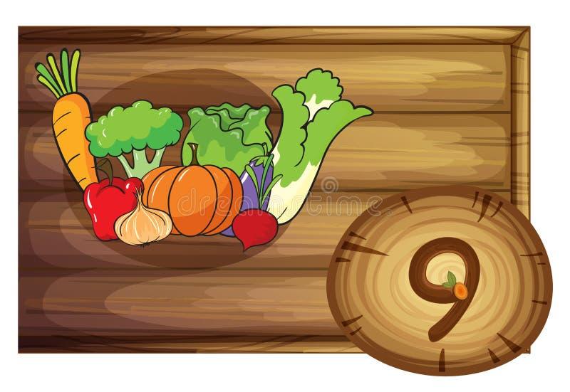 Un cadre en bois avec neuf légumes illustration libre de droits