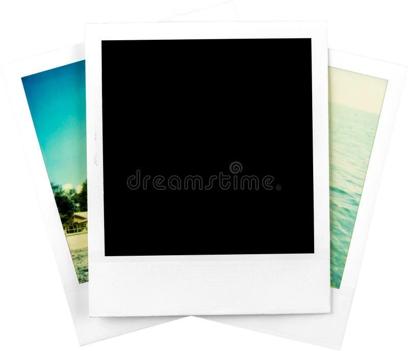 Un cadre polaroïd en blanc et deux photos polaroïd - photos libres de droits