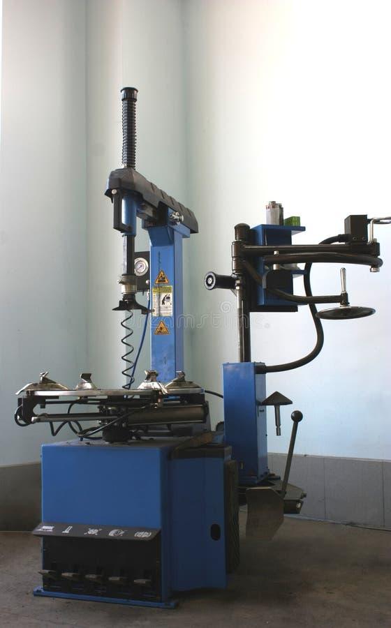 Un cambiador del neumático foto de archivo libre de regalías