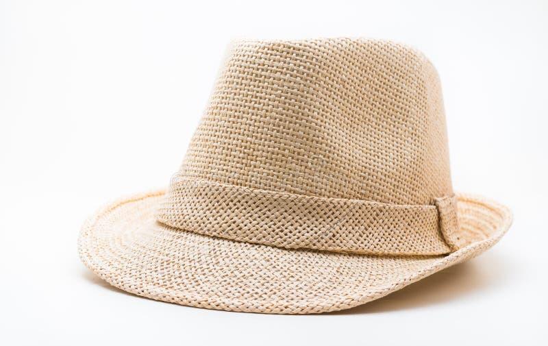 Un cappello di paglia marrone su fondo bianco fotografie stock