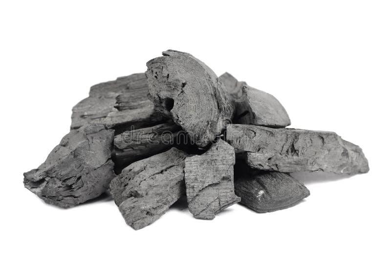 un carbón de leña del negro del puñado fotografía de archivo libre de regalías