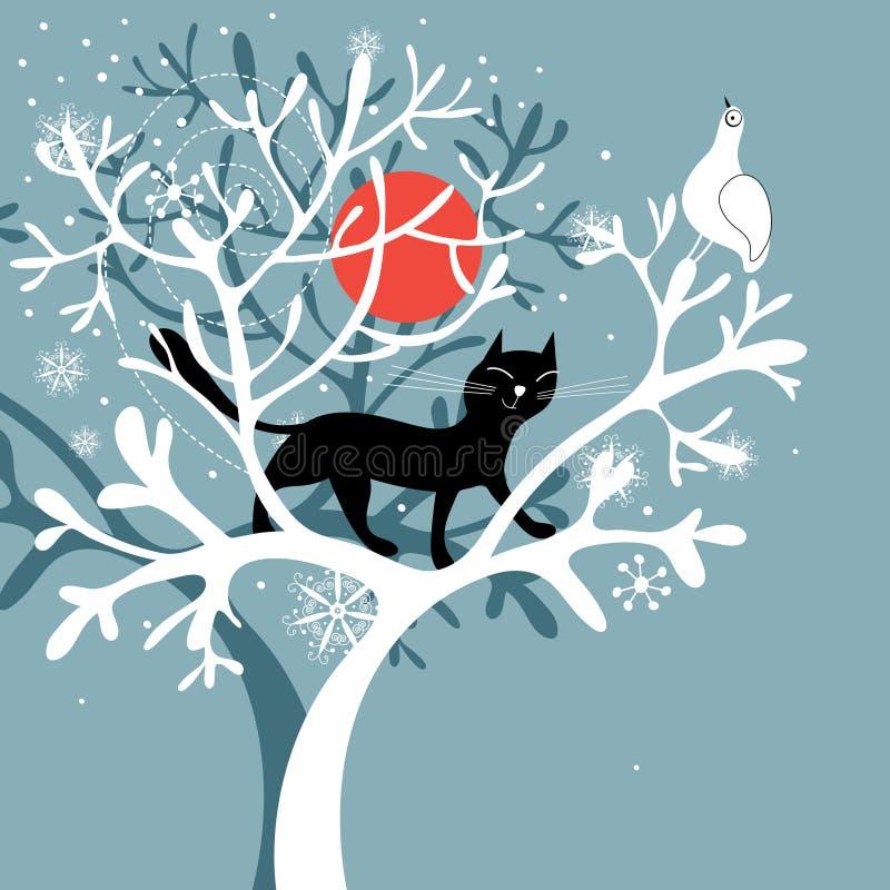 Un chat noir sur l'arbre snow-covered