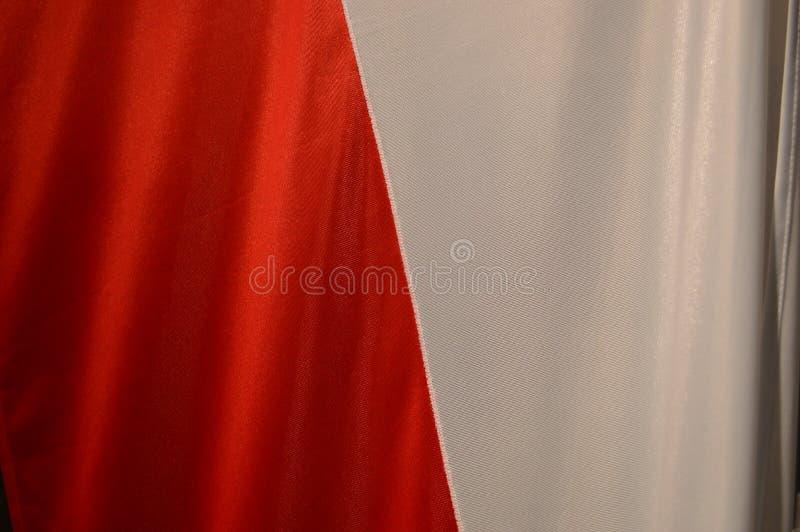 Un cierre para arriba de la bandera polaca fotografía de archivo