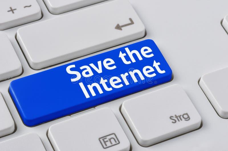Un clavier avec un bouton bleu - sauvez l'Internet photos stock