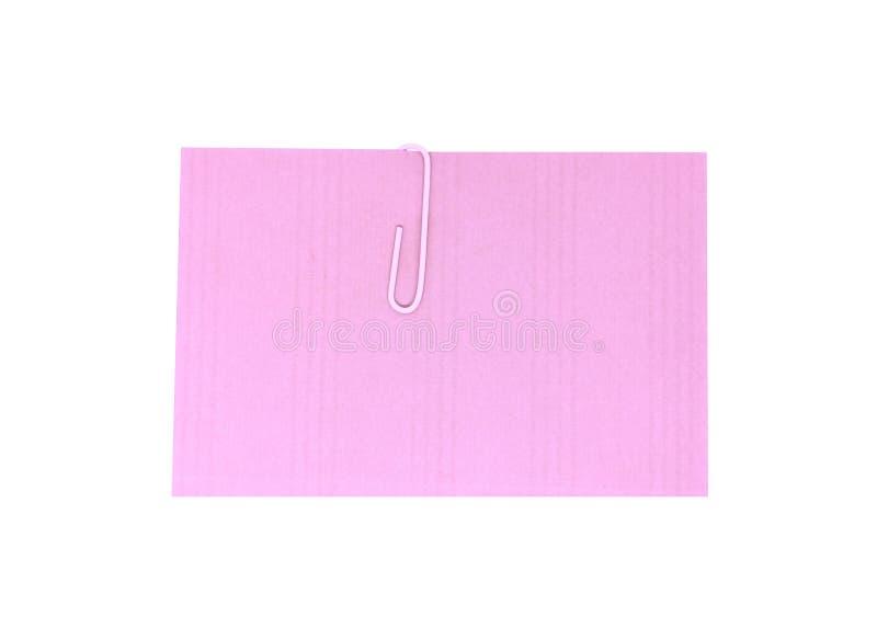 Un clip blanco con un papel rosa en blanco Hoja rosa para el mensaje o para agregar más texto Nota pro memoria con clip de papel fotografía de archivo