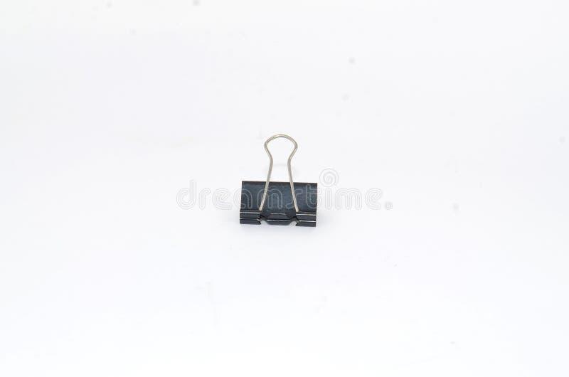 Un clip de papel negro grande hecho del hierro negro fotos de archivo libres de regalías