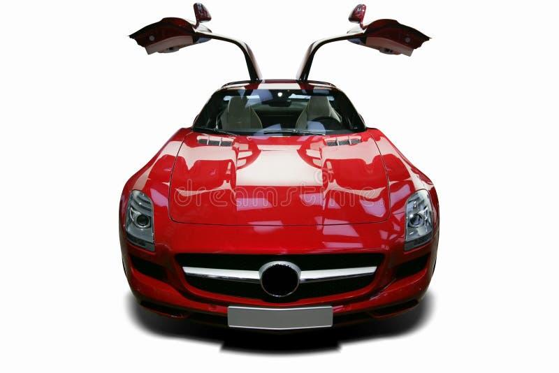 Un coche de carreras de alta calidad estático rojo independiente adentro foto de archivo libre de regalías