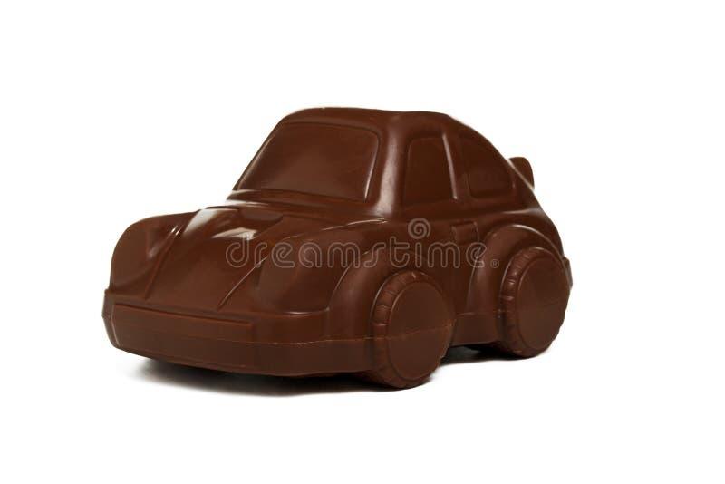 Un coche del chocolate en el fondo blanco imagenes de archivo