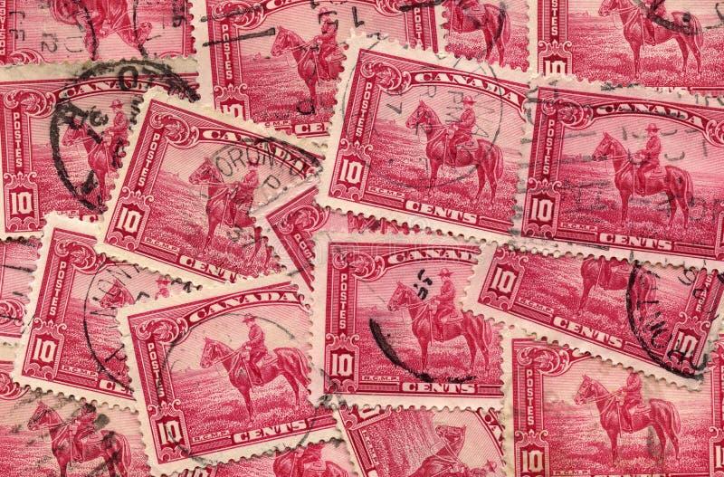 Un collage del bollo canadese 1935 del Mountie immagine stock