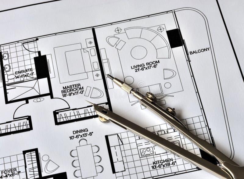 Un compás en la tapa de la residencia floorplan imagen de archivo libre de regalías