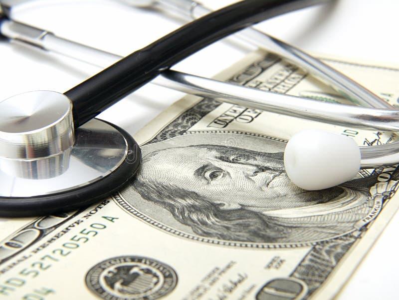 Un concepto médico del dinero imagen de archivo