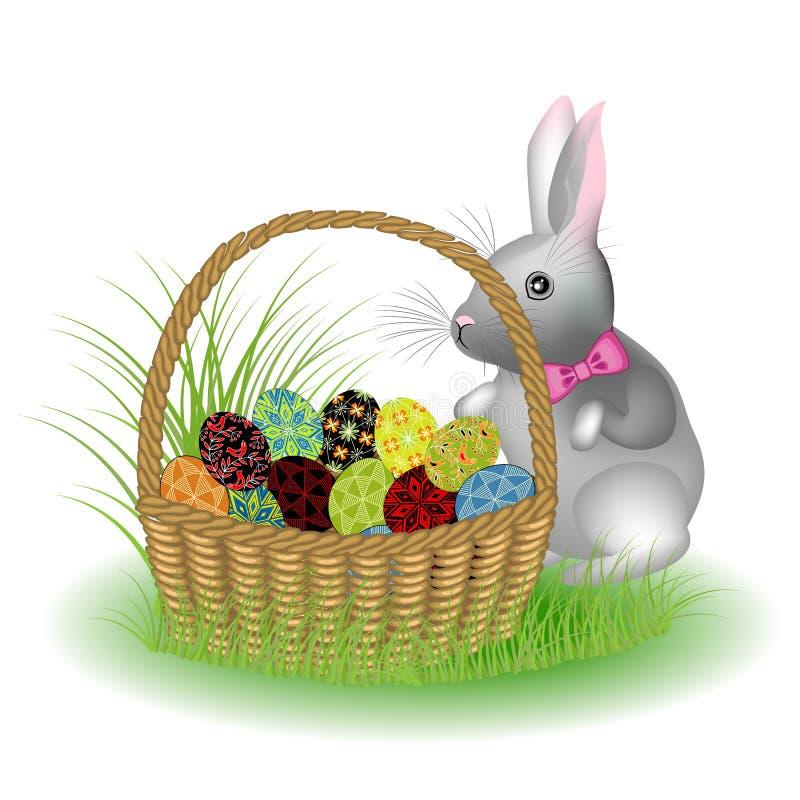 Un coniglio sveglio grigio sta sedendosi in un canestro con le uova di Pasqua dipinte Il simbolo di Pasqua nella cultura di molti illustrazione vettoriale