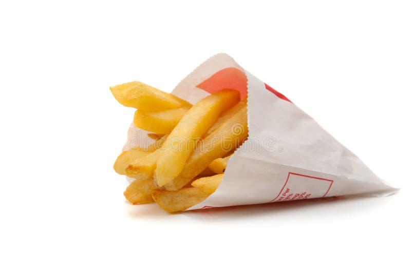 Un conjunto de patatas fritas en un fondo blanco fotos de archivo libres de regalías