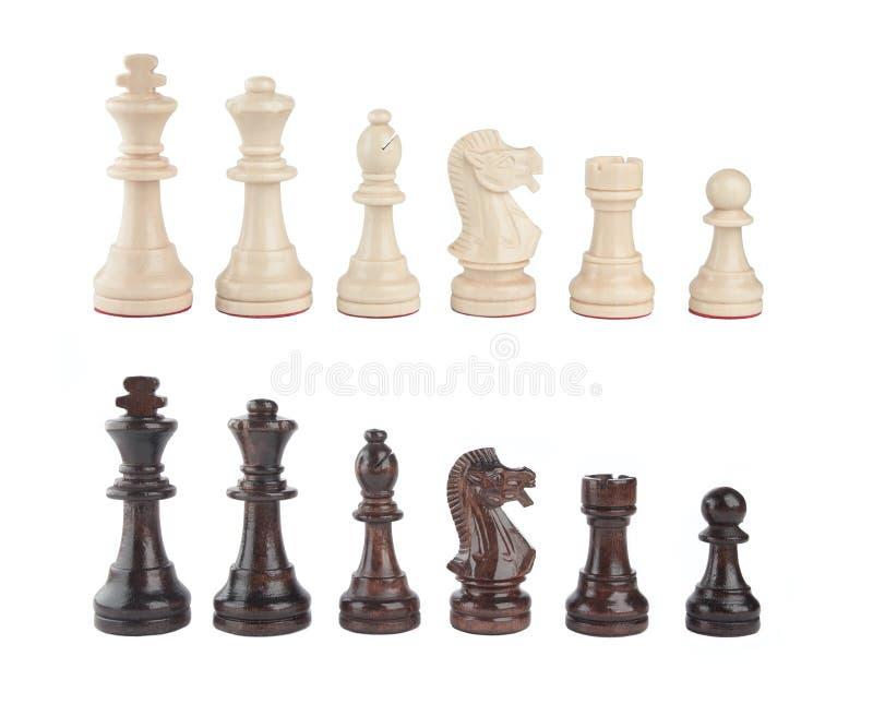 Un conjunto de pedazos de ajedrez blancos y negros foto de archivo