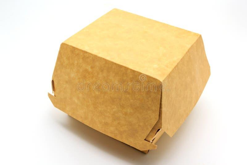 Un contenitore marrone di alimento, imballante per l'hamburger, il pranzo, gli alimenti a rapida preparazione, l'hamburger ed il  fotografia stock
