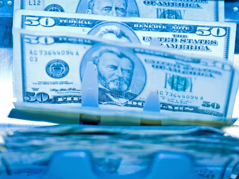 Un counte d'argent électronique photos libres de droits