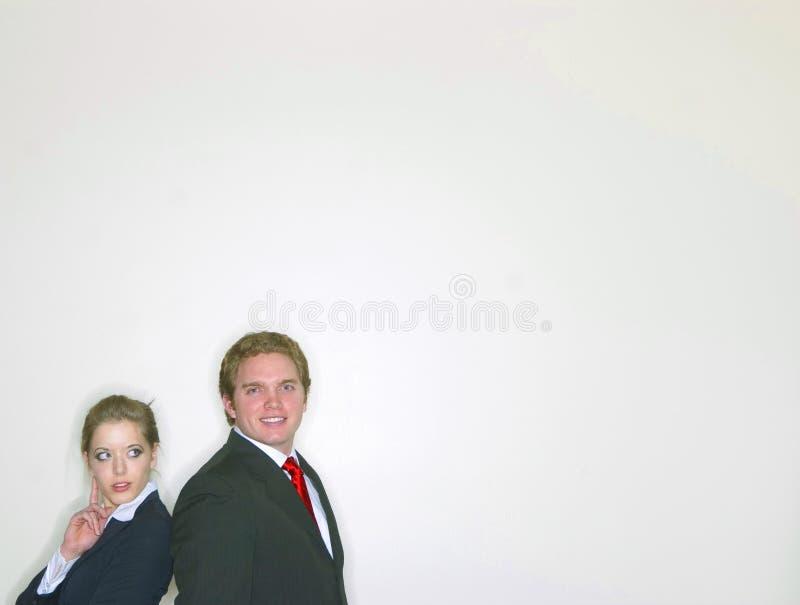 Un couple dans le vêtement d'affaires image stock