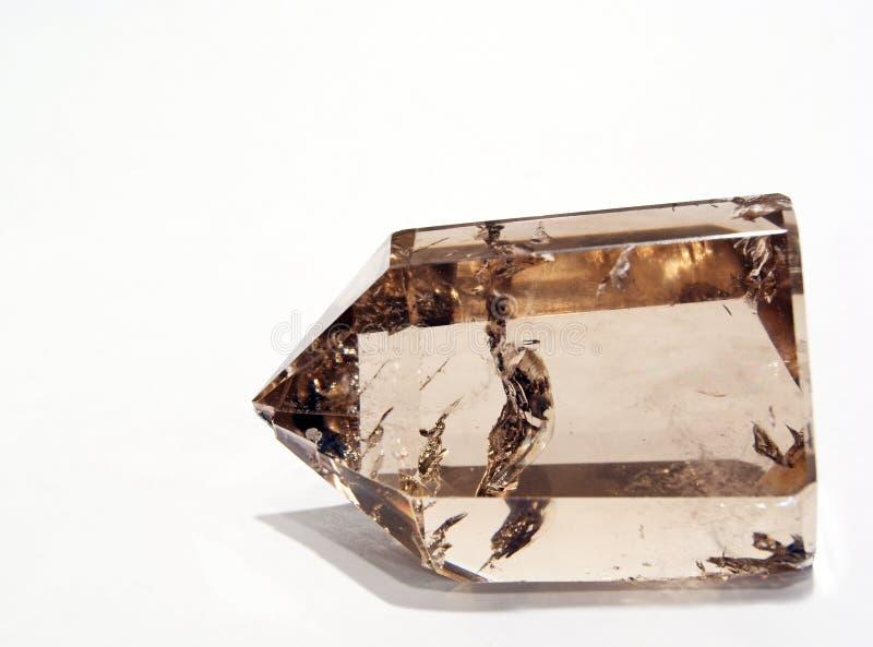 Cristal de quartz fumeux dans la lumière artificielle image libre de droits