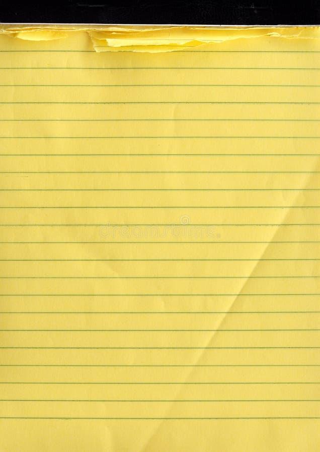 Un cuaderno de notas amarillo imagen de archivo libre de regalías