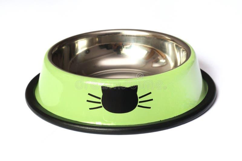 Un cuenco de alimentación coloreado verde luminoso del animal doméstico fotos de archivo libres de regalías