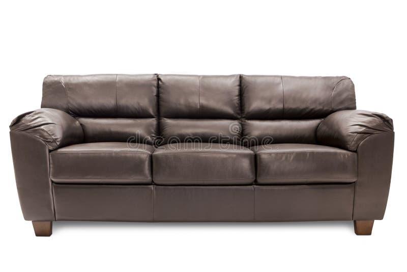 Un cuoio marrone accogliente di tre sedili immagini stock libere da diritti