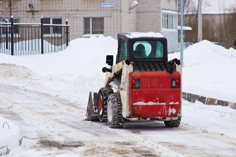 Un déblaiement de neige automatisé photographie stock libre de droits
