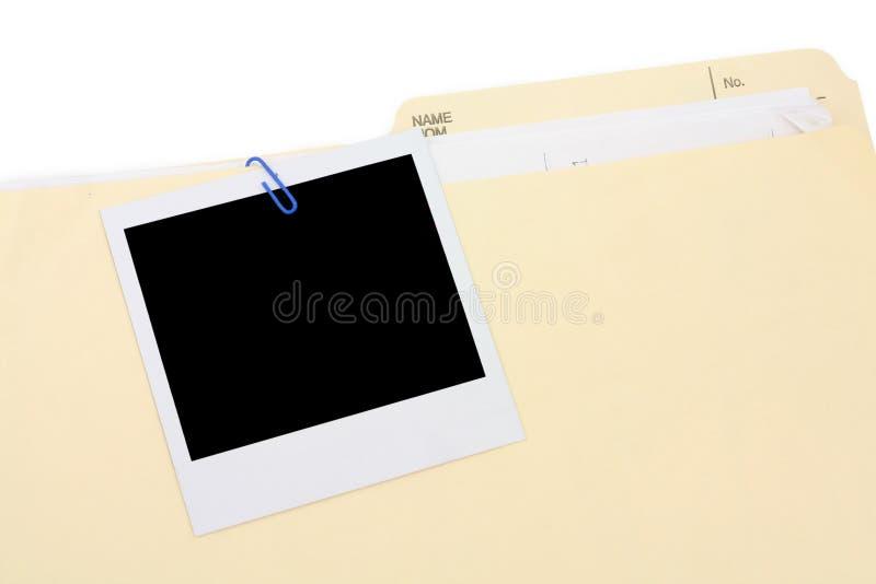 Un dépliant polaroïd de photo et de fichier photos libres de droits