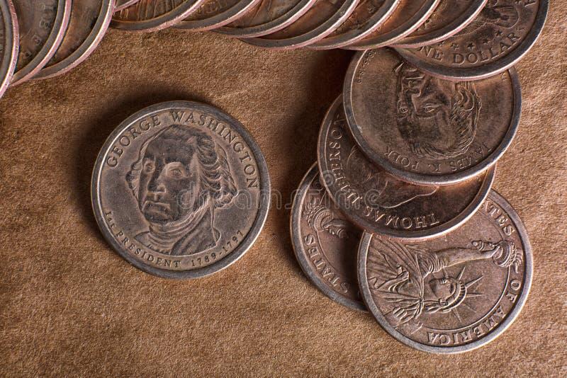 Un dólar acuña el primer imágenes de archivo libres de regalías