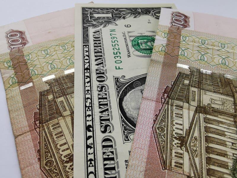 Un dólar y doscientos rublos rusos imagenes de archivo