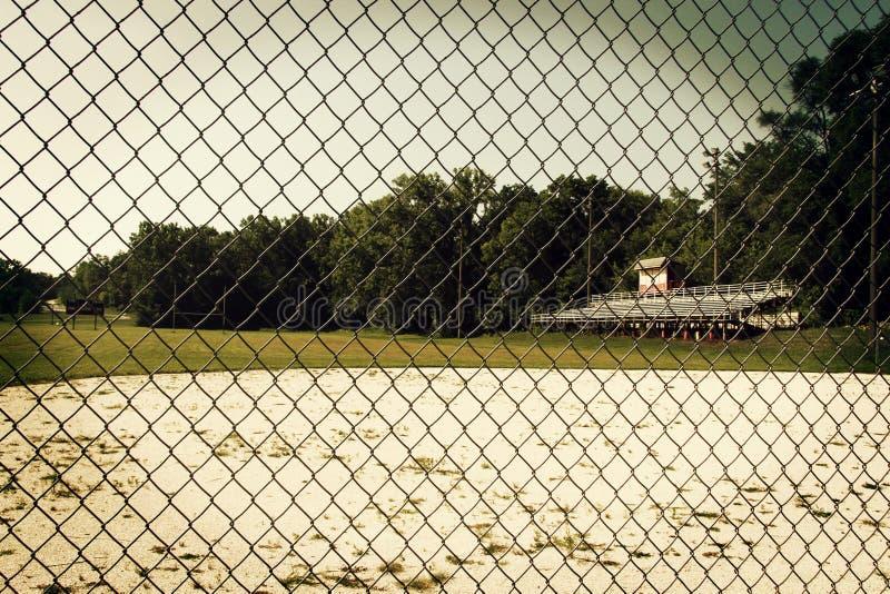 Un diamant de base-ball envahi images stock