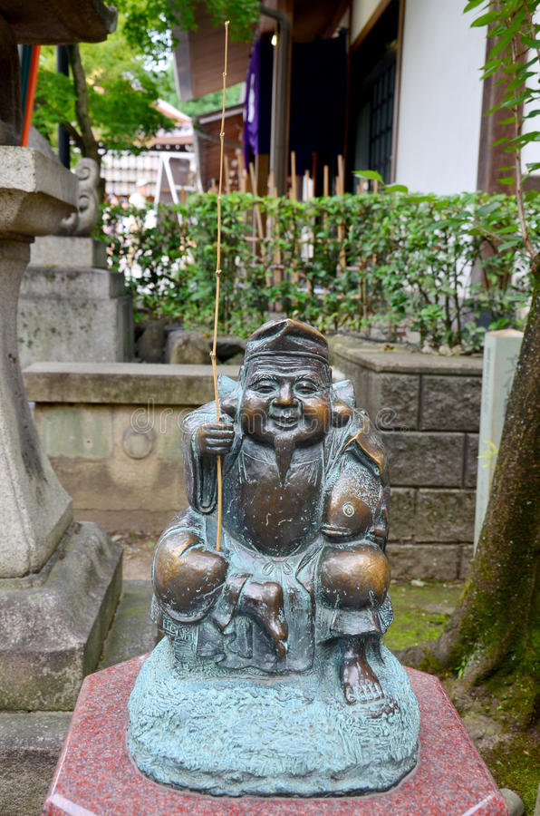 Un dieu de statue d'Ebisu des pêcheurs ou des négociants est les sept dieux des FO photo stock