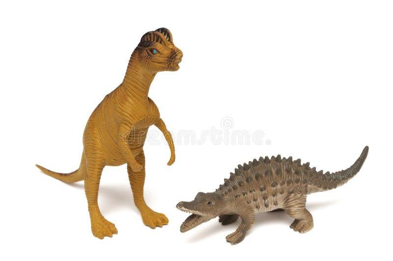 Un Dilophosaurus et un dinosaure écallieux lombo-sacré différent jouent des figurines image libre de droits