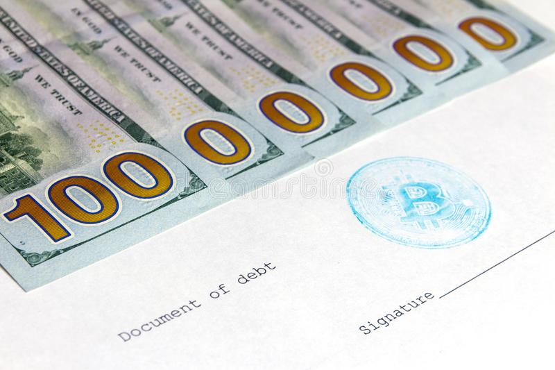 Un document de dette avec un timbre bleu de beatcoin à côté de l'endroit pour la signature Un million de dollars sur cinq cents photo stock